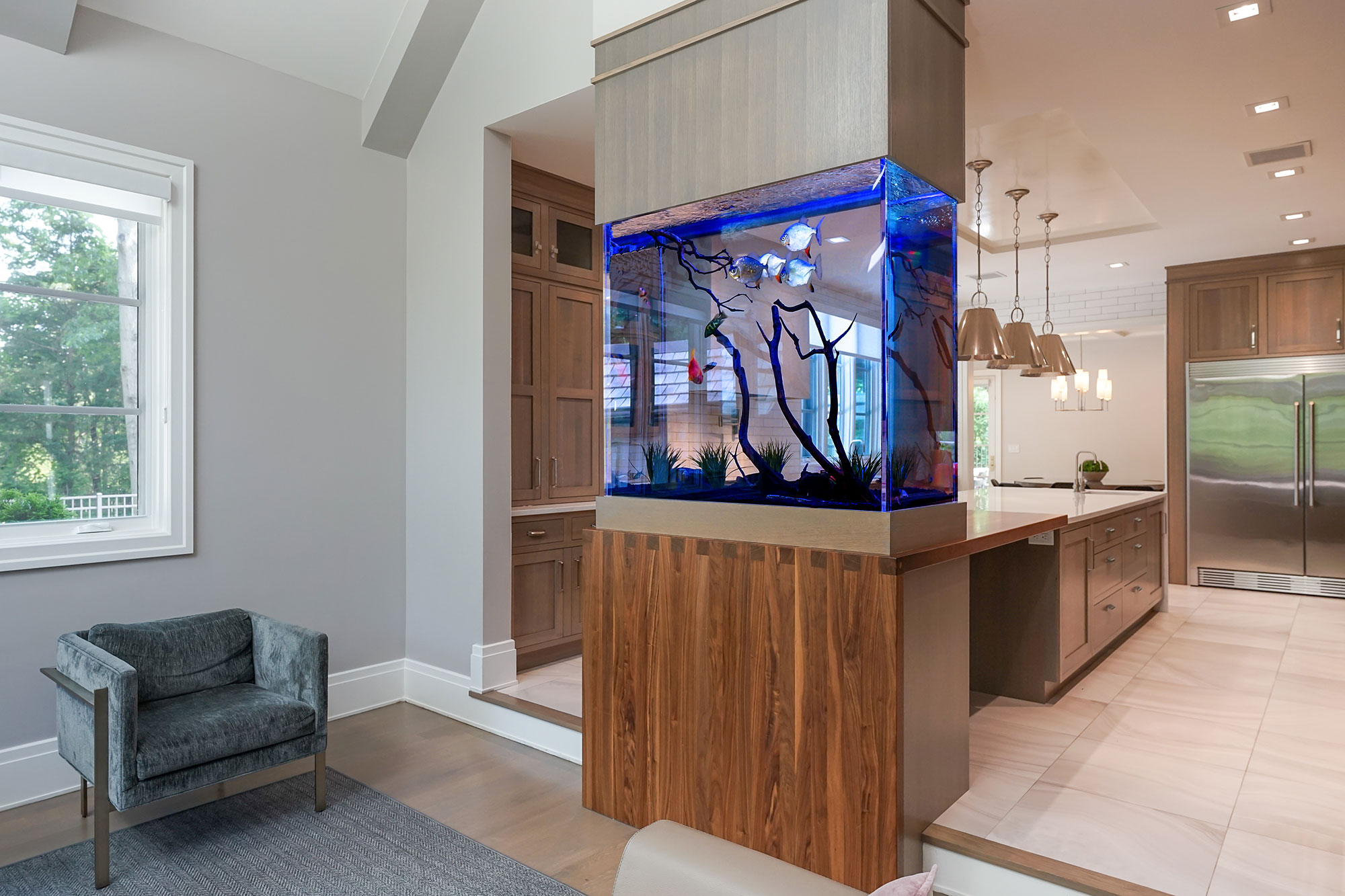 Kitchen island fish tank viewed from living room