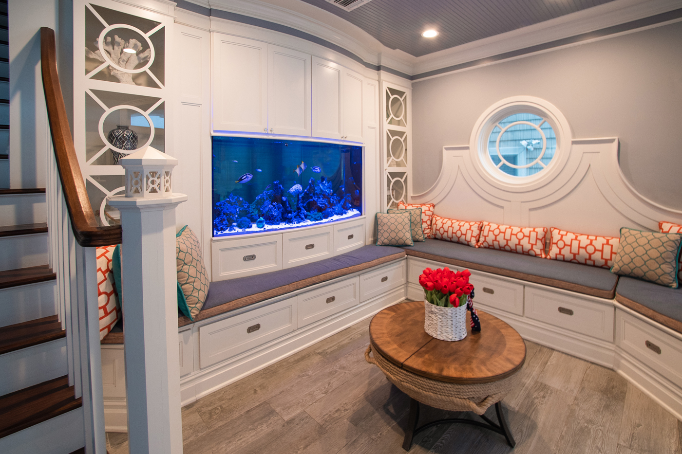One side of this NJ beach house aquarium faces into a sitting room