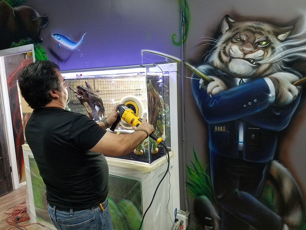 Buffing out acrylic scratches under the watchful eye of a tiger